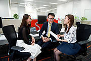 SHANGHAI, CHINA - MAY 13: Standard Chartered bank employees Anlan Cai (right), Charles Zhang (center), and Doris Zheng (left) have a meeting in Standard Chartered tower in Pudong Luziajui business district, on May 13, 2015, in Shanghai, China. (Photo by Lucas Schifres/Pictobank)