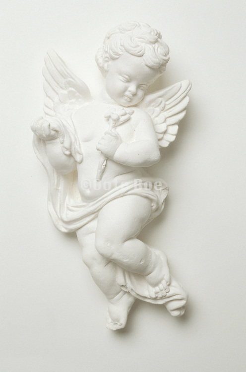 a little cupid figure against a white background