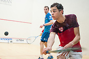 BIRMINGHAM, MICHIGAN, USA - JANUARY 25: Ali Farag (Egypt), front, and Nick Matthew (England) compete in the championship match of the 2016 Motor City Open (MCO), presented by The Suburban Collection, squash tournament Monday, January 25, 2016 at the Birmingham Athletic Club in Birmingham, Michigan. Farag won the MCO championship. (Photo by Bryan Mitchell)