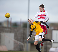 Stirling Albion's Ross Smith over East Fife&rsquo;s Jamie Insall. <br /> Half time : East Fife 0 v 0 Stirling Albion, Scottish Football League Division Two game played atBayview Stadium, 20/2/2106.
