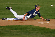 060911-Evergreen, COLORADO-ehsbaseball-Evergreen High School's Jake Spicer (No. 2) narrowly misses a bouncing ground ball during the third inning Thursday, June 9, 2011 at EHS. The Cougars defeated the Nitro, 8-3..Photo By Matthew Jonas/Evergreen Newspapers/Photo Editor