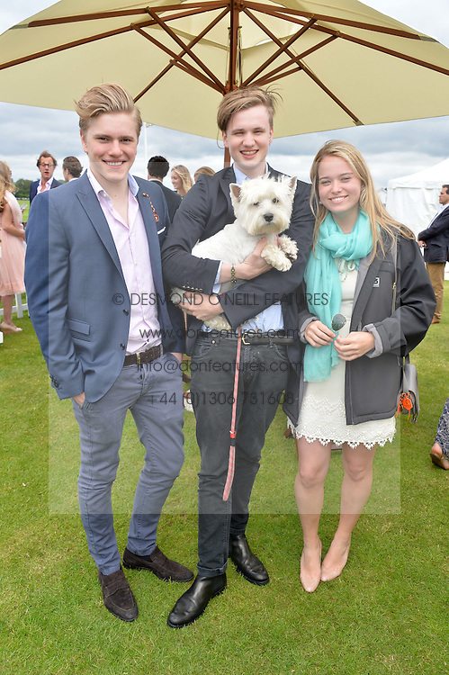 Left to right, JAMIE BARKER, HUG BAMBERGER and MARINA VERE-NICOLL with Lincoln the dog at the Cartier Queen's Cup Final polo held at Guards Polo Club, Smith's Lawn, Windsor Great Park, Egham, Surrey on 15th June 2014.
