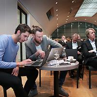 Nederland, Amsterdam , 26 maart 2015.<br />  Buzzcapture en ANP organiseren samen Buzz15. Hét jaarlijkse evenement voor klanten en prospects: marketing-communicatie managers, woordvoerders, corporate communicatie managers en CEO's in de Hermitage.<br /> Op de foto: midden Jaap van Zessen van Buzzcapture en rechts Remco Icke van UWV<br /> Foto:ANPinOpdracht/Jean-Pierre Jans