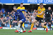 Chelsea Forward Gonzalo Higuain on loan from Juventus & Wolverhampton Wanderers defender Conor Coady (16) during the Premier League match between Chelsea and Wolverhampton Wanderers at Stamford Bridge, London, England on 10 March 2019.