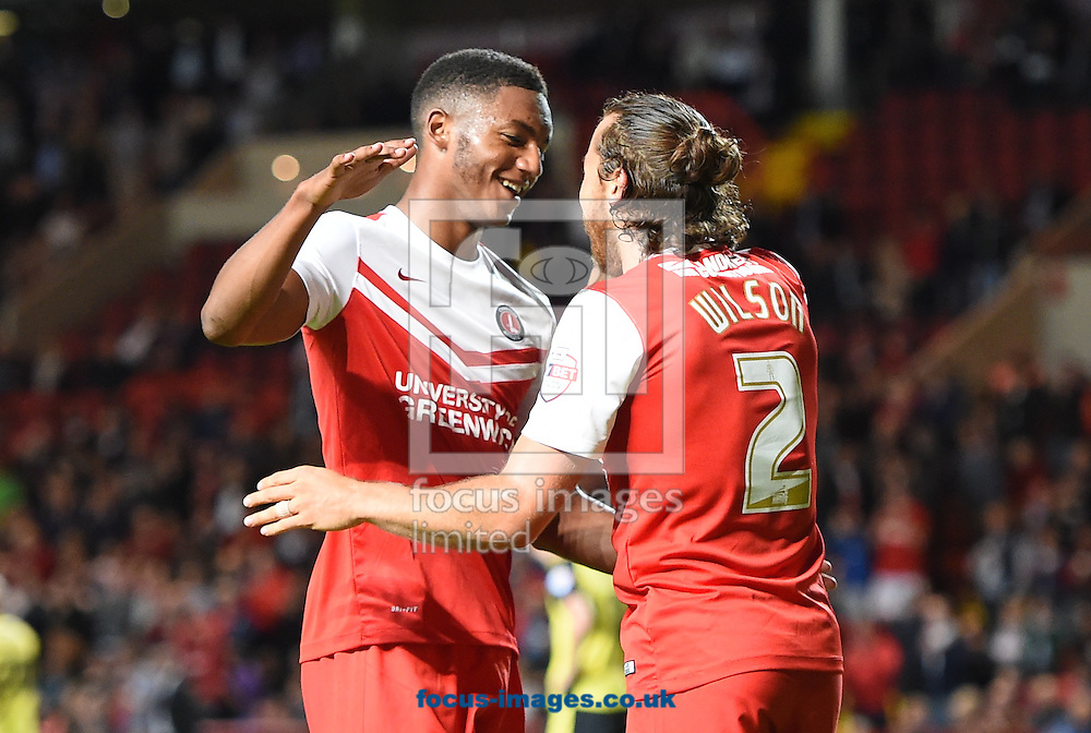 Lawrie Wilson of Charlton Athletic celebrates scoring his side's 3rd goal and his 2nd with Joe Gomez to make it 3-0 on the night during the Capital One Cup match at The Valley, London<br /> Picture by Alan Stanford/Focus Images Ltd +44 7915 056117<br /> 12/08/2014