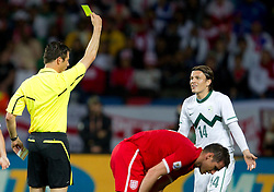Referee Wolfgang Stark with yellow card for Zlatko Dedic of Slovenia during the 2010 FIFA World Cup South Africa Group C Third Round match between Slovenia and England on June 23, 2010 at Nelson Mandela Bay Stadium, Port Elizabeth, South Africa. England defeated Slovenia 1-0 and qualified for the next round, Slovenia not. (Photo by Vid Ponikvar / Sportida)