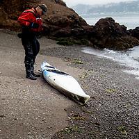 Ray checks out an abandoned kayak