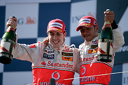 Melbourne. Australia - Sunday, March 18, 2007: Fernando Alonso and team-mate Lewis Hamilton (GBR, Vodafone McLaren Mercedes) celebrate their podium finishes at the opening Grand Prix of the Formula One World Championship in Australia.(Pic by Michael Kunkel/Propaganda/Hoch Zwei)