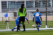 Charlotte Gurr and Charlotte Owen (10) retrieve the ball from the Cardiff goal during the FA Women's Premier League match between Brighton Ladies and Cardiff City Ladies at Brighton's Training Ground, Lancing, United Kingdom on 22 March 2015. Photo by Geoff Penn.