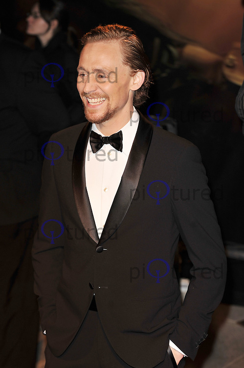 LONDON - JANUARY 08: Tom Hiddleston attends the UK Premiere of 'War Horse' at the Odeon Cinema, Leicester Square, London, England on January 08 2012. (Photo By Awais Butt)