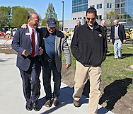 Cedar Rapids Mayor Ron Corbett (from left), City Council member Don Karr, and Linn County Supervisor Brent Oleson share a laugh as they walk to the new Federal Courthouse in Cedar Rapids on Tuesday morning, April 10, 2012. (Stephen Mally/Freelance)