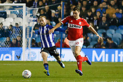 Middlesbrough defender Dael Fry (20) goes past Sheffield Wednesday midfielder Barry Bannan (10)  during the EFL Sky Bet Championship match between Sheffield Wednesday and Middlesbrough at Hillsborough, Sheffield, England on 19 October 2018.