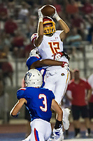 Jesuit Marauders Evan Panson (12), catches the ball as he is tackled by Folsom Bulldogs Isaiah Barner (16), during the first quarter as the Folsom Bulldogs host the Jesuit Marauders,  Friday Sep 1, 2017. The Game was moved to Folsom from Jesuit due to the high temperatures. <br /> photo by Brian Baer