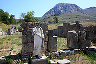 A headless statue stands in Ancient Corinth.