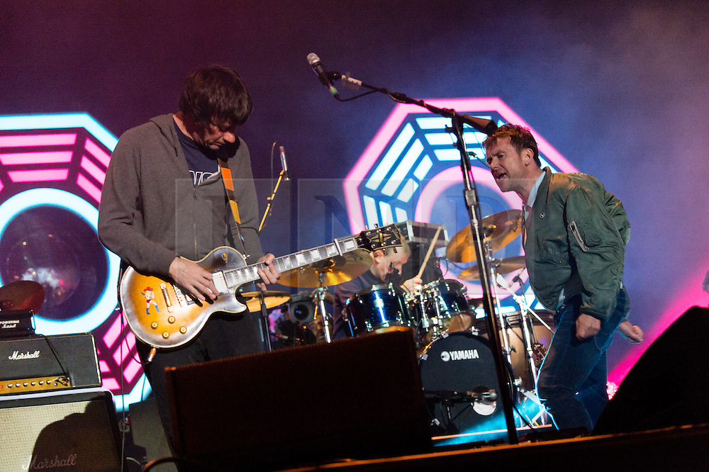 © Licensed to London News Pictures. 13/06/2015. Isle of Wight, UK.   Blur performing live at Isle of Wight Festival 2015, Day 3 Saturday,headlining the main stage.  In this picture - Graham Coxon (left), Damon Albarn (right).   Headline acts include The Prodigy, Blur and Fleetwood Mac.   Photo credit : Richard Isaac/LNP