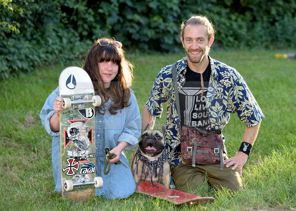 © Licensed to London News Pictures.  06/07/2017; Bath & West Showground, Somerset, UK. NASS, National Action Sports Show festival. CLARE MACLEAN and JOEL DEASON with EROC THE DOG is a French Bulldog from London that loves skateboarding. The world's leading BMX and skate athletes will compete in the West Country this weekend as the IBMXFF World Championships and Europe's leading skate contest return to NASS Festival. The annual action sport and music festival, which takes place on the 6th – 9th July near Bristol will host the BMX World Championships for the second year running, after the games returned to the UK for the first time in 28 years last year. The event will be one of the largest global BMX freestyle and skate events of the year with more than 450 professional and amateur athletes from over 40 countries heading to the festival. Earlier this month it was announced that BMX Freestyle has been added to the programme of the Tokyo 2020 Olympic Games highlighting the growth and incredible standard of this sport. Olympics hopefuls and reigning BMX Champions Logan Martin, Vince Byron and Nick Bruce will all return to defend their titles across Pro Park, Vert and Dirt. The competition will be hosted by BMX's greatest legend, Mat Hoffman. Picture credit : Simon Chapman/LNP