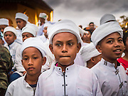 17 JUNE 2015 - YAHA, YALA, THAILAND: Thai Islamic students look for the crescent moon at the Hilal in Yaha Wednesday. Thousands of people came to Yaha District in Yala province of Thailand for the Hilal - the first sighting of the crescent moon that marks the official beginning of the Muslim holy month of Ramadan. Despite cloudy weather and intermittent rain showers, the moon was sighted and religious leaders declared the official beginning of Ramadan.    PHOTO BY JACK KURTZ