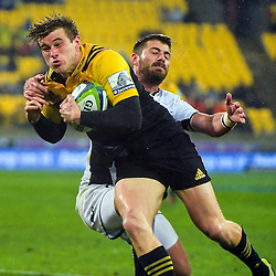 Willie Le Roux tries to stop Jason Woodward during the Super Rugby quarterfinal match between the Hurricanes and Sharks at Westpac Stadium, Wellington, New Zealand on Saturday, 23 July 2016. Photo: Dave Lintott / lintottphoto.co.nz