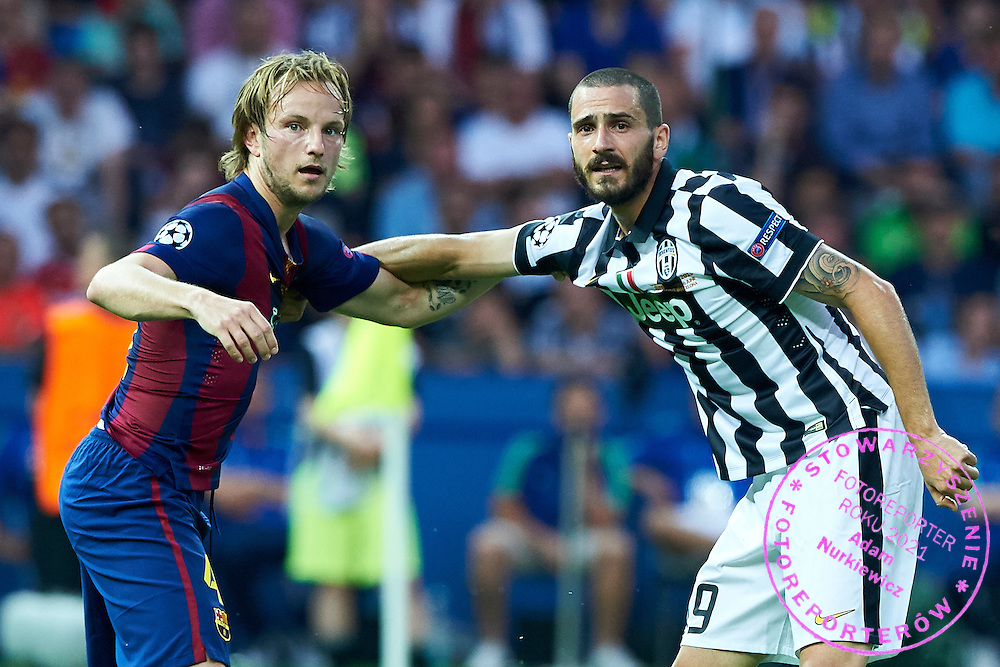 (L) Ivan Rakitic of FC Barcelona fights for the ball with (R) Leonardo Bonucci from Juventus during the 2014/15 UEFA Champions League Final between Juventus and FC Barcelona at Olympiastadion on June 6, 2015 in Berlin, Germany.<br /> Germany, Berlin, June 6, 2015<br /> <br /> Picture also available in RAW (NEF) or TIFF format on special request.<br /> <br /> For editorial use only. Any commercial or promotional use requires permission.<br /> <br /> Adam Nurkiewicz declares that he has no rights to the image of people at the photographs of his authorship.<br /> <br /> Mandatory credit:<br /> Photo by &copy; Adam Nurkiewicz / Mediasport