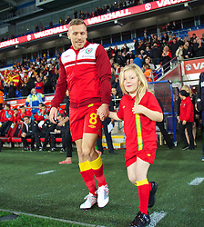 11.10.2013, City Stadion, Cardiff, WAL, FIFA WM Qualifikation, Wales vs Mazedonien, Gruppe A, im Bild Wales' Craig Bellamy walks out for his final home game for his country with his daughter Lexie before the FIFA World Cup Qualifier Group A Match between Wales and Macedonia at the City Stadium, Cardiff, Wales on 2013/10/11. EXPA Pictures © 2013, PhotoCredit: EXPA/ Propagandaphoto/ David Rawcliffe<br /> <br /> ***** ATTENTION - OUT OF ENG, GBR, UK *****
