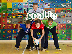No Repro Fee: 10/04/13.Leinster star Ian Madigan surprises school kids for GOAL .Pictured here is GOAL CEO Barry Andrews with Conor O'Neill (left), age 12, Adam Klug, age 12 and Sam Dabiator,age 11..The boys and girls of Kill O' The Grange primary school in Deansgrange got a big surprise when Leinster and Ireland rugby star, Ian Madigan paid them a surprise visit to launch a new annual fundraiser for GOAL on 10/04/13. Madigan was helping the aid agency promote their 'GOAL Sports Challenge', a multi-sport event that hopes to boost fitness levels amongst children and teenagers, and also raise money and awareness for some of GOAL's programmes for vulnerable children throughout the developing world..For schools interested in signing up, please email schools@goal.ie for further information about GOAL's work go to www.goal.ie , www.facebook.com/goalireland , @GOALIreland ..Pic: Andres Poveda.