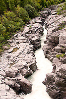 Ticino, Southern Switzerland. The milky Maggia river flowing through the rocky terrain of the Ponte Brolla.