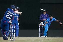 © Licensed to London News Pictures. 23/09/2012. England batsmen Craig Kieswetter hits Indian bowler Ashok Dinda during the T20 Cricket World T20 match between England Vs India at the R.Premadasa Cricket Stadium,Colombo. Photo credit : Asanka Brendon Ratnayake/LNP