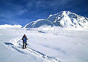 Alaska. Hatchers Pass , Talkeetna Mountains. Woman snowshoeing.