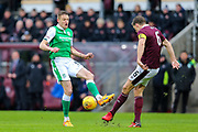 Vykintas Slivka (#8) of Hibernian attempts to block the clearance from Christophe Berra (#6) of Heart of Midlothian during the William Hill Scottish Cup 4th round match between Heart of Midlothian and Hibernian at Tynecastle Stadium, Gorgie, Scotland on 21 January 2018. Photo by Craig Doyle.