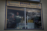 Owners Ann Nelson and her son Brian pose in the window of the Patricia Theatre in Powell River, BC. The mother and son team took over the 100-year-old theatre in 2002. (2013)
