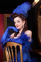 Showgirl sitting on chair