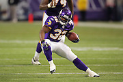 MINNEAPOLIS - NOVEMBER 21:  Running back Onterrio Smith #32 of the Minnesota Vikings gains some of his 27 yards on 8 carries against the Detroit Lions at the Hubert H. Humphrey Metrodome on November 21, 2004 in Minneapolis, Minnesota. The Vikings defeated the Lions 22-19. ©Paul Anthony Spinelli  *** Local Caption *** Onterrio Smith