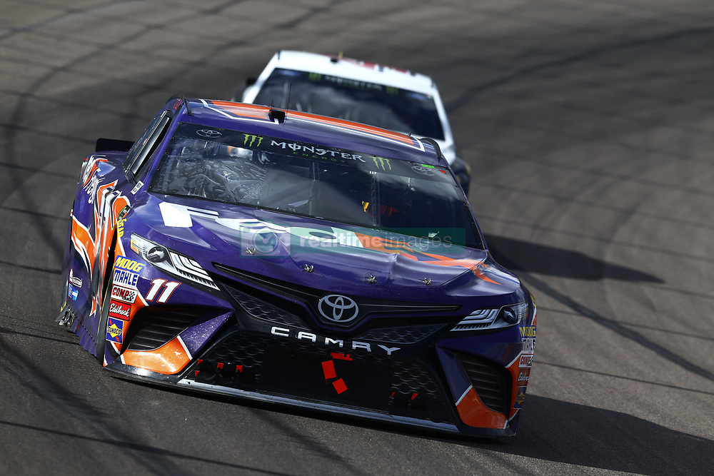 March 11, 2018 - Avondale, Arizona, United States of America - March 11, 2018 - Avondale, Arizona, USA: Denny Hamlin (11) brings his car through the turns during the Ticket Guardian 500(k) at ISM Raceway in Avondale, Arizona. (Credit Image: © Chris Owens Asp Inc/ASP via ZUMA Wire)