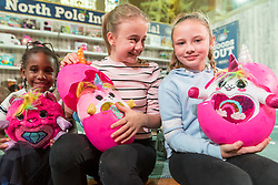 "© Licensed to London News Pictures. 14/11/2018. LONDON, UK. Emmie, aged 5, Amy, aged 11, and Bella, aged 10, play with Pomsies by Bandai. Preview of ""DreamToys"", the official toys and games Christmas Preview, held at St Mary's church in Marylebone.  Recognised as the countdown to Christmas, the Toy Retailer's Association, an independent panel of leading UK toy retailers, have selected the definitive and most authoritative list of what toys will be the hottest property this Christmas. [Child models provided by show organisers, permission obtained to be photographed].  Photo credit: Stephen Chung/LNP"