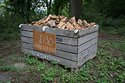 A crate of chopped logs for sale by a man called George for £130 on 10th September 2018, near Lingen, Herefordshire, England UK.