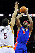 Feb. 9, 2011; Cleveland, OH, USA; Detroit Pistons power forward Chris Wilcox (9) shoots over Cleveland Cavaliers center Ryan Hollins (5) during the fourth quarter at Quicken Loans Arena. The Pistons beat the Cavaliers 103-94 for Cleveland's 26th loss in a row. Mandatory Credit: Jason Miller-US PRESSWIRE