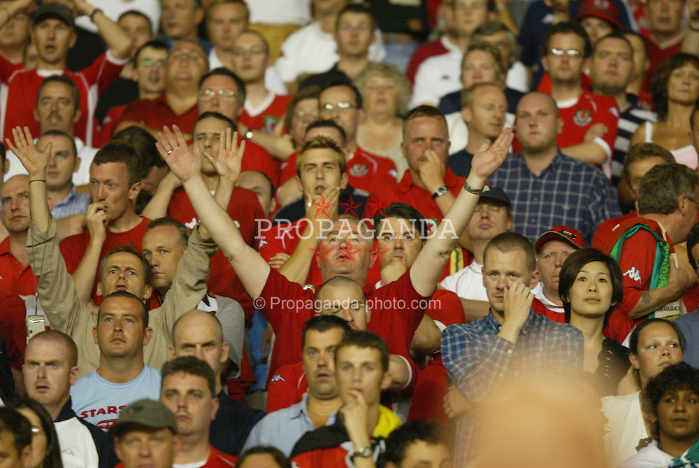 BELGRADE, SERBIA & MONTENEGRO - Wednesday, August 20, 2003: Wales' fans look dejected after losing 1-0 to Serbia & Montenegr during the UEFA European Championship qualifying match at the Red Star Stadium. (Pic by David Rawcliffe/Propaganda)