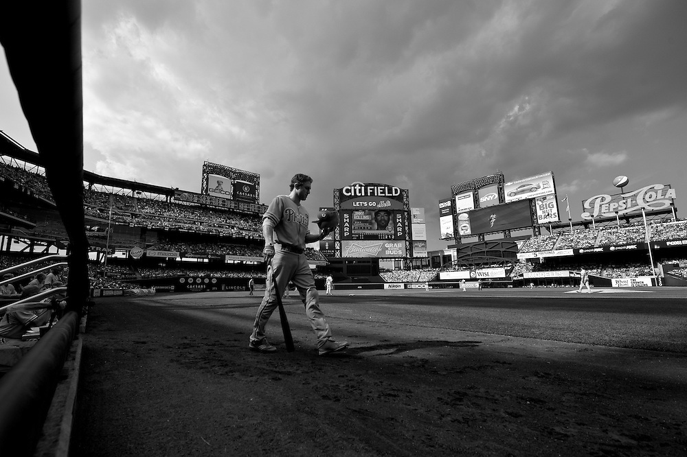 NEW YORK - JULY 16: ***EDITORS NOTE*** This image was digitally converted to Black & White) Chase Utley #26 of the Philadelphia Phillies walks onto the field during the game against the New York Mets at Citi Field on July 16, 2011 in the Queens borough of Manhattan. (Photo by Rob Tringali) *** Local Caption *** Chase Utley