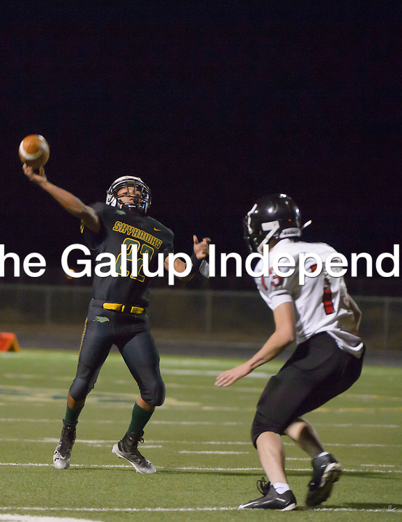 Skyhawks junior Deondre Begay throws a deep pass to downfield for a touchdown Friday night in Newcomb.