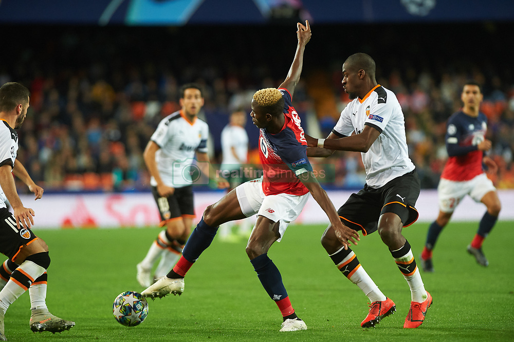 November 5, 2019, Valencia, Valencia, Spain: Geoffrey Kondogbia of Valencia and Victor James Osimhen of Losc Lille during the during the UEFA Champions League group H match between Valencia CF and Losc Lille at Estadio de Mestalla on November 5, 2019 in Valencia, Spain (Credit Image: © AFP7 via ZUMA Wire)