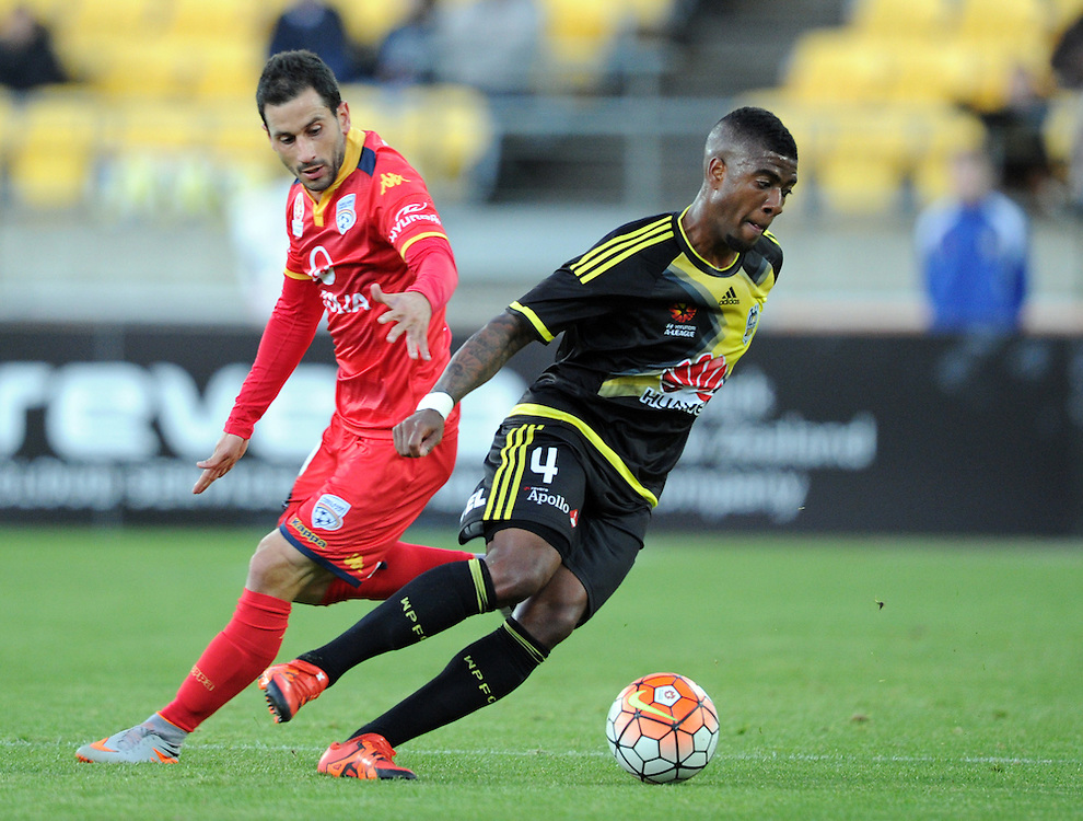 Phoenix's Rolieny Bonevacia turns in front of Adelaide United's Sergio Cirio in the A-League football match at Westpac Stadium, Wellington, New Zealand, Friday, November 13, 2015. Credit:SNPA / Ross Setford