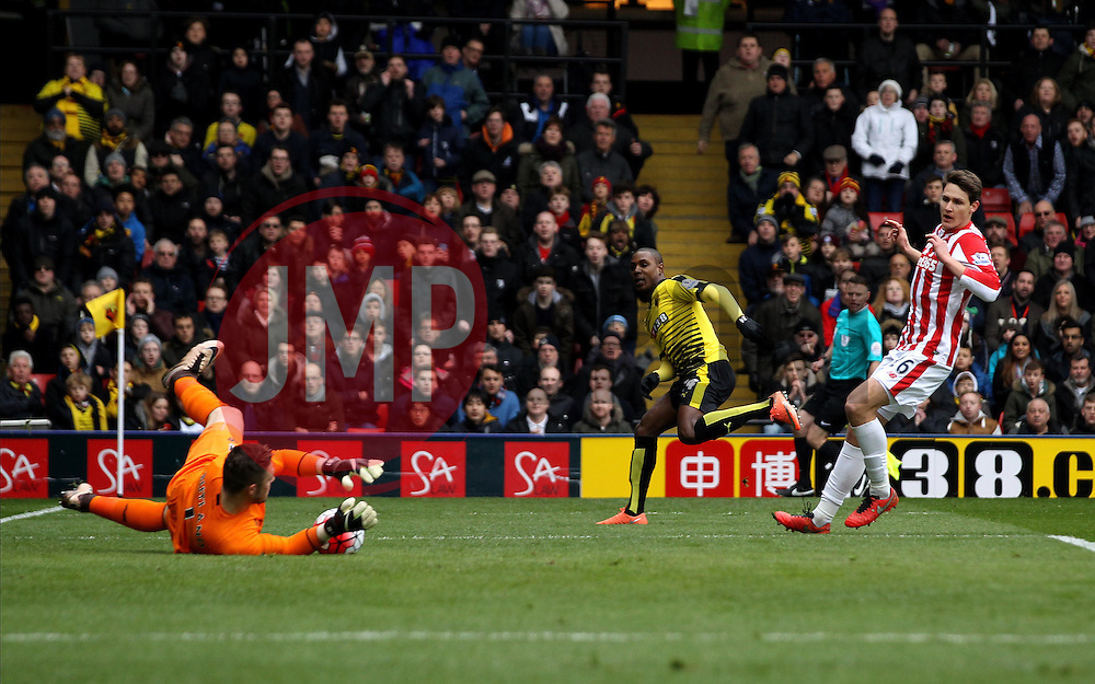 Odion Ighalo of Watford sees his shot saved by Jack Butland of Stoke City - Mandatory byline: Robbie Stephenson/JMP - 19/03/2016 - FOOTBALL - Vicarage Road - Watford, England - Crystal Palace v Leicester City - Barclays Premier League