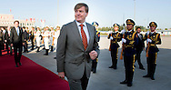 King Willem-Alexander of The Netherlands arrive at Yan'an Ershilipu Airport and are welcomed by mr Zhao Min, Foreign Affairs Office Province Shaanxi in China, 27 October 2015. The King and Queen are in china for an 5 day state visit. COPYRIGHT ROBIN UTRECHT