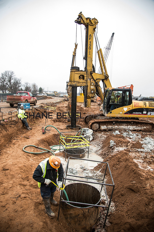 1/21/16 12:17:32 PM --  Construction work at The Gathering Place including setting and pouring the foundation of the lodge, drilling piers along riverside, and dredging the bottom of the pond.  <br /> <br /> Photo by Shane Bevel