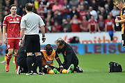 Hull City midfielder Mohammed Diame recieves attention for injuryduring the Sky Bet Championship match between Hull City and Middlesbrough at the KC Stadium, Kingston upon Hull, England on 7 November 2015. Photo by Ian Lyall.