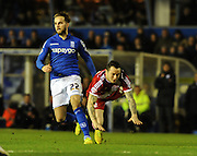 Andrew Shinnie brings Lee Tomlin crashing down during the Sky Bet Championship match between Birmingham City and Middlesbrough at St Andrews, Birmingham, England on 18 February 2015. Photo by Simon Kimber.