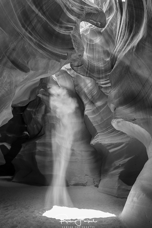 Shortly before noon the sun casts it's rays just right and the caverns come alive as sand falls in the light.