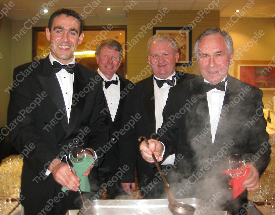 Darragh Hassett, Michael McInerry, Sean Moran and Pat Hannon looking after the punch bowl at the Clare Hunt Ball in the West County Hotel.