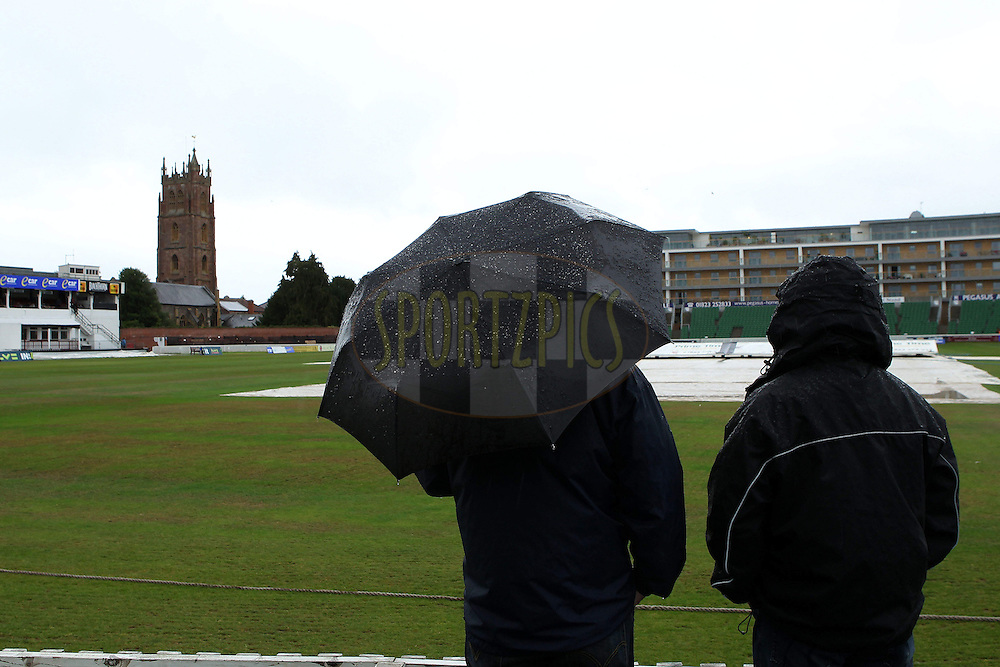 Fans look hopefully towards the field as the rain continues to come down during day two of the tour match between Somerset and India held at the Somerset Cricket County Ground in Taunton, Somerset, England on the 16th July 2011...Photo by Ron Gaunt/SPORTZPICS/BCCI