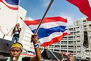 Anti-government protestors wave Thai flags in the courtyard at the Ministry of Finance in Bangkok. Protestors opposed to the government of Thai Prime Minister Yingluck Shinawatra spread out through Bangkok this week. Protestors have taken over the Ministry of Finance, Ministry of Sports and Tourism, Ministry of the Interior and other smaller ministries. The protestors are demanding the Prime Minister resign, the Prime Minister said she will not step down. This is the worst political turmoil in Thailand since 2010 when 90 civilians were killed in an army crackdown against Red Shirt protestors. The Pheu Thai party, supported by the Red Shirts, won the 2011 election and now govern. The protestors demanding the Prime Minister step down are related to the Yellow Shirt protestors that closed airports in Thailand in 2008.